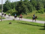 Guests riding horses in front of Alluring View